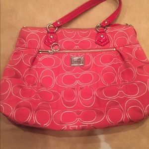 Red coach purse with wallet.